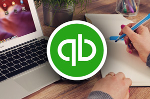 Working with QuickBooks on laptop
